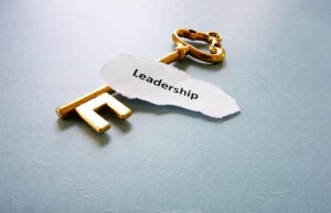 antique key with Leadership text on paper, macro
